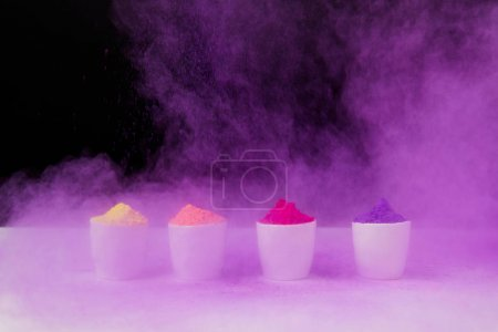 Photo for Row of tradition holi powder in bowls on black, Hindu spring festival of colours - Royalty Free Image
