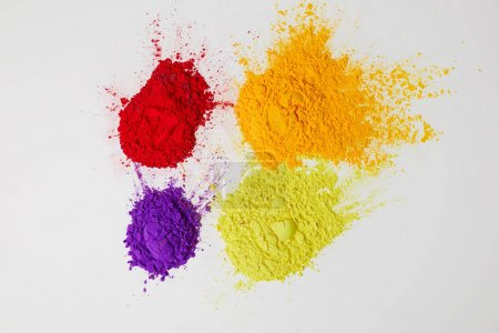 top view of four colors of holi powder for Hindu spring festival,  isolated on white