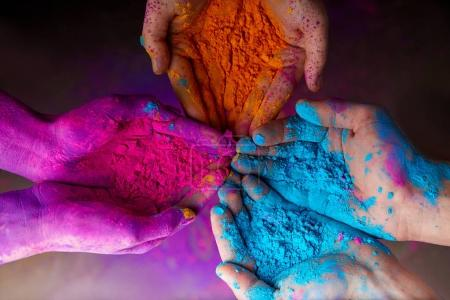 Photo for Cropped view of hands with holi powder for Hindu spring festival of colours - Royalty Free Image