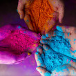 Cropped view of hands with holi powder for Hindu s...