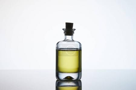 Photo for Closed bottle of aromatic massage oil on white - Royalty Free Image