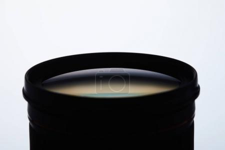 close-up shot of camera lens silhouette on white
