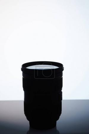 single camera lens silhouette on white