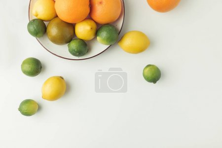 Juicy citruses on plate isolated on white background