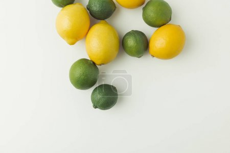 Green limes and lemons isolated on white background