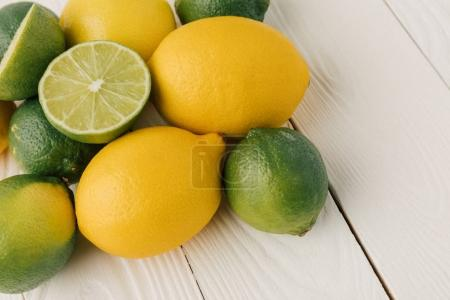 Raw citruses on white wooden background