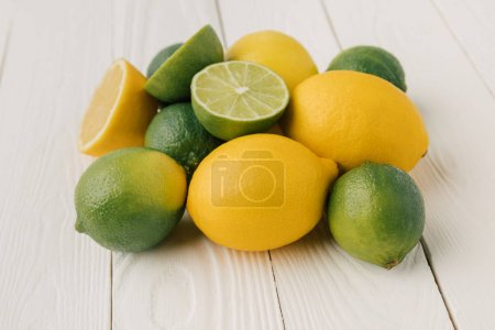 Juicy citruses on white wooden background