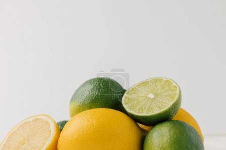 Green and Key limes isolated on white background