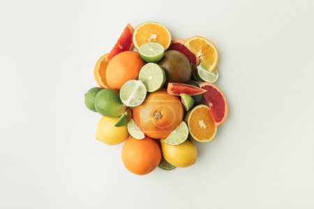 Photo for Pile of citrus fruits isolated on white background - Royalty Free Image