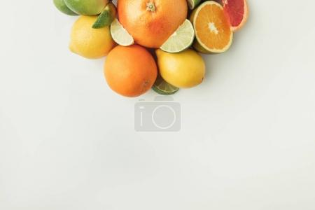 Pile of juicy citruses isolated on white background