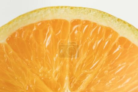 Close-up view of ripe orange fruit flesh isolated on white background