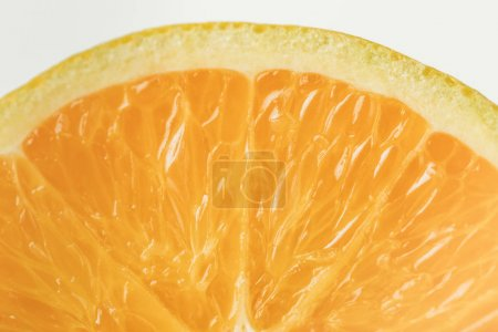 Photo for Close-up view of ripe orange fruit flesh isolated on white background - Royalty Free Image