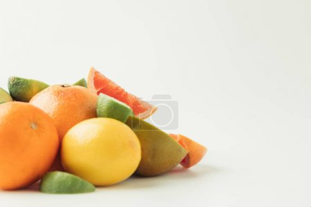 Pile of raw citruses isolated on white background