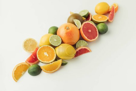 Pile of ripe citruses isolated on white background