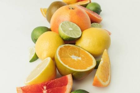 Heap of citrus fruits isolated on white background