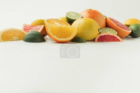 Assorted juicy citruses isolated on white background