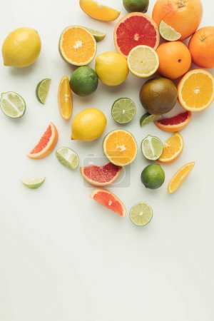 Photo for Whole and sliced citruses isolated on white background - Royalty Free Image