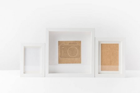 Photo for Close-up view of various empty white photo frames on white - Royalty Free Image