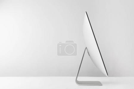 side view of modern desktop computer on white