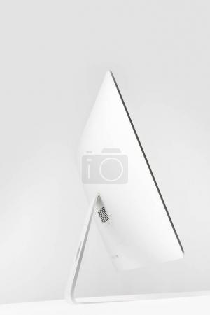 Photo for Side view of desktop computer display on white - Royalty Free Image