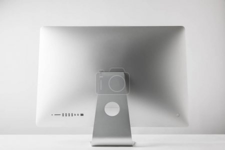Photo for Back view of desktop computer monitor on white - Royalty Free Image