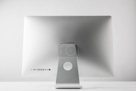 back view of desktop computer monitor on white