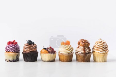 Photo for Close up view of various sweet cupcakes isolated on white - Royalty Free Image