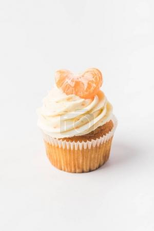 close up view of sweet cupcake with cream and tangerine isolated on white