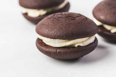 selective focus of chocolate cookies with cream isolated on white