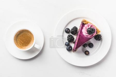 Photo for Top view of piece of cake with berries and cup of coffee isolated on white tabletop - Royalty Free Image