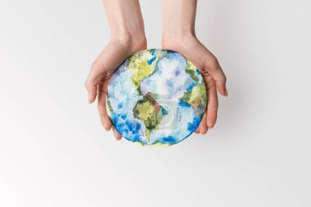 cropped shot of woman holding handmade globe in hands isolated on grey, environment protection concept