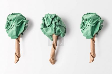 top view of paper made green trees isolated on grey, recycling and environment protection concept