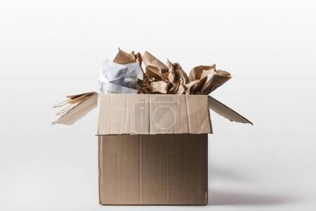 Photo for Close up view of cardboard box with papers inside isolated on white - Royalty Free Image