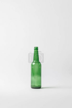 close up view of empty glass bottle isolated on grey, recycling concept