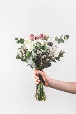 cropped shot of woman holding beautiful bridal bouquet isolated on grey