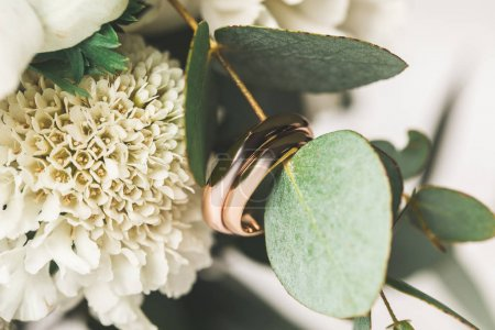 Photo for Close up view of wedding rings in bridal bouquet - Royalty Free Image