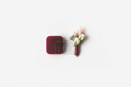 top view of jewelry box and boutonniere isolated on white