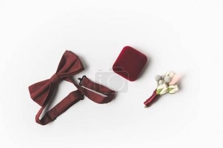 flat lay with buttonhole, bow tie and jewelry box isolated on white