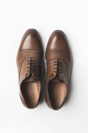 Photo for Top view of pair of grooms shoes isolated on white - Royalty Free Image
