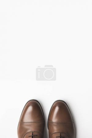top view of pair of grooms shoes isolated on white
