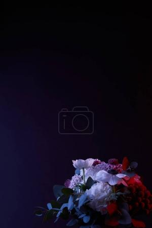 bouquet of beautiful different flowers on dark