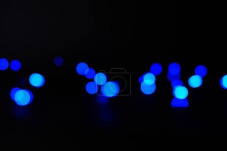 abstract dark blue bokeh background or texture