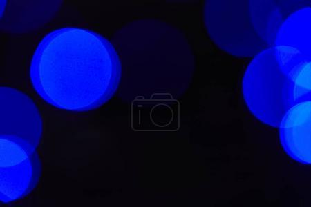 abstract dark blue bokeh circles background