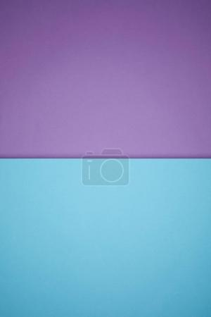 geometric textured background with blue and purple colored paper