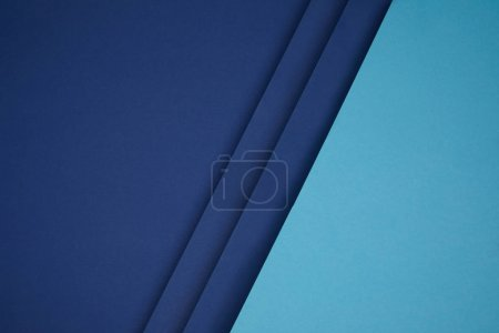 dark and bright blue geometric paper background