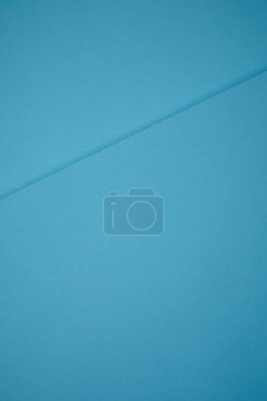 blue abstract background from colored paper