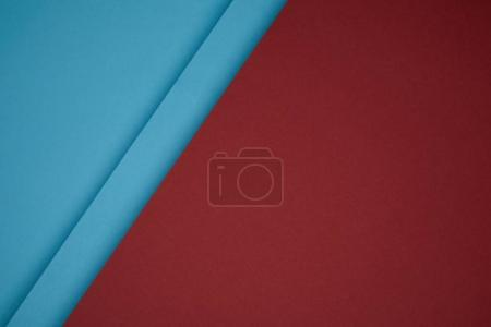 close up view of geometric background from red and blue colored paper