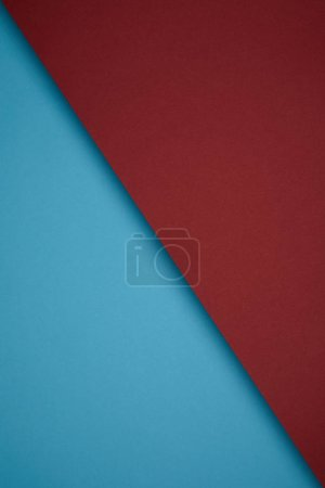 close up view of creative geometric background from red and blue colored paper