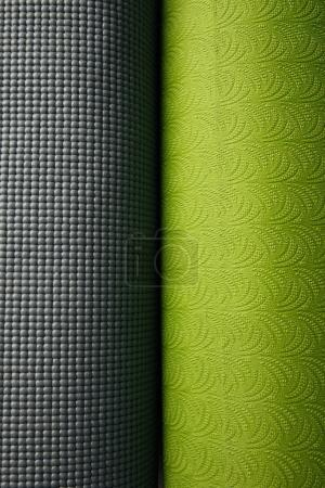 top view of two green and grey yoga mats
