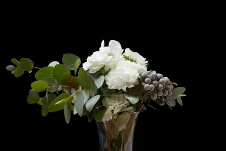 Tender flowers in vase isolated on black